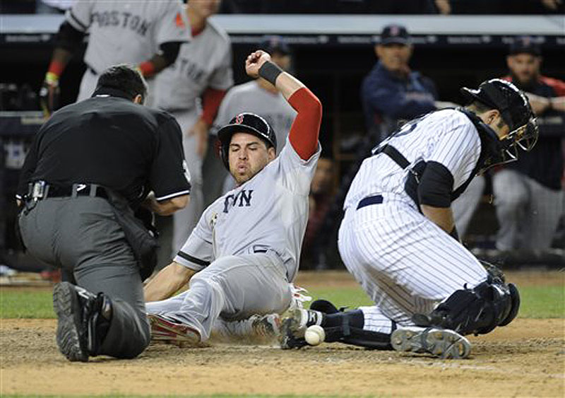 Boston center fielder Jacoby Ellsbury scores on a single by Shane Victorino on Thursday as New York Yankees catcher Austin Romine, right, cannot handle the throw. Home Plate umpire Rob Drake is at left. Ellsbury has a broken foot and will remain out of the lineup for an unspecified period.