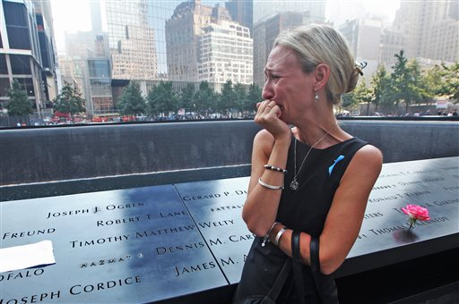 Carrie Bergonia of Pennsylvania looks over the name of her fiance, firefighter Joseph Ogren, at the 9/11 Memorial during ceremonies marking the 12th anniversary of the attacks on the World Trade Center in New York.