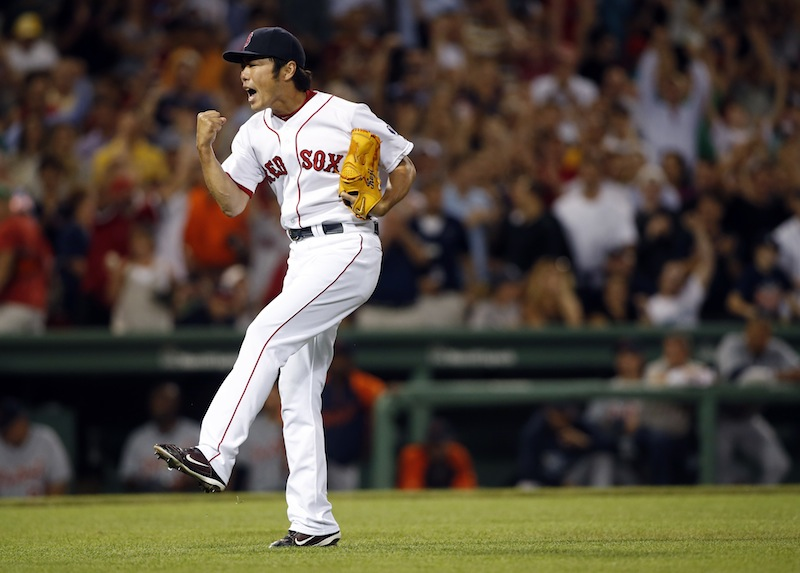 Boston closer Koji Uehara celebrates after defeating the Detroit Tigers 2-1 at Fenway Park Tuesday.
