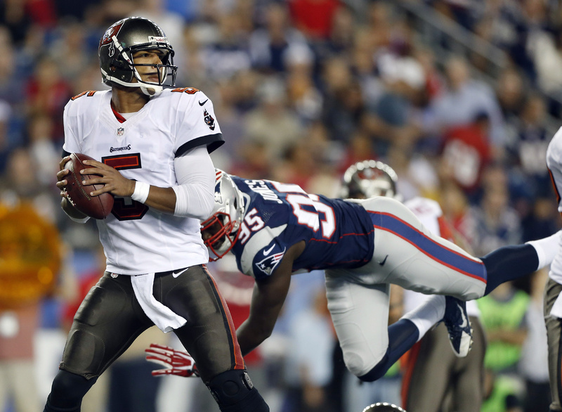 Tampa Bay Buccaneers quarterback Josh Freeman looks to pass against the rush of New England Patriots defensive end Chandler Jones in a preseason game in August. The two teams face each other Sunday.