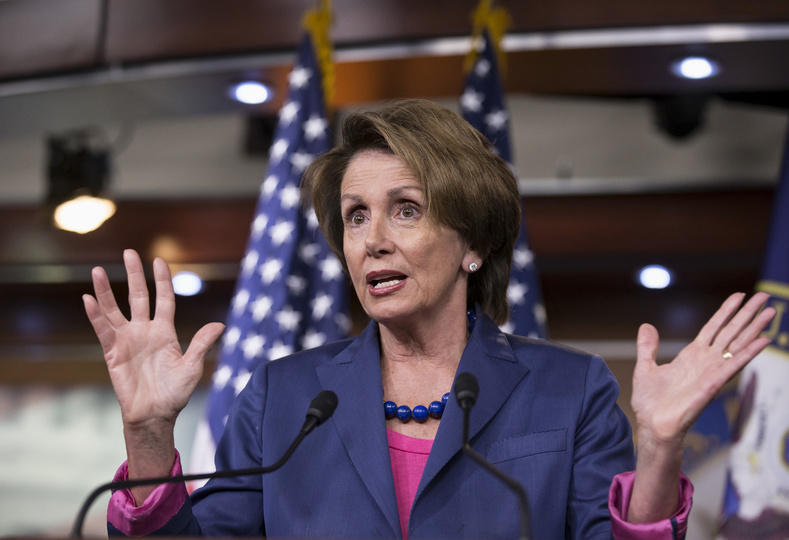 House Minority Leader Nancy Pelosi of California gestures while speaking during a news conference on Capitol Hill in Washington on Friday as Congress continues to struggle over how to fund the government and prevent a possible shutdown.