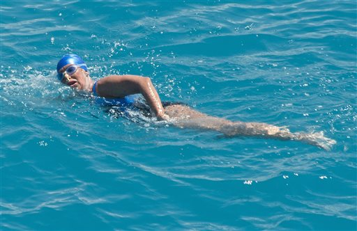 In this Monday, Sept. 2, 2013, photo Diana Nyad, positioned about two miles off Key West, Fla., swims toward the completion of her 111-mile trek from Cuba to the Florida Keys.