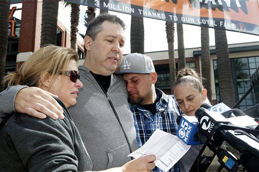 From left, Jill Haro, aunt; Robert Preece, father; Robert Preece Jr., brother; and Diana Denver, mother, of Los Angeles Dodgers fan Jonathan Denver, make a public plea Sunday before the Giants' baseball game in San Francisco for witnesses to the fatal stabbing Wednesday of Jonathan Denver. Jonathan Denver, 24, was stabbed Wednesday during a melee following a game between the Giants and the Los Angeles Dodgers. AT&T Park
