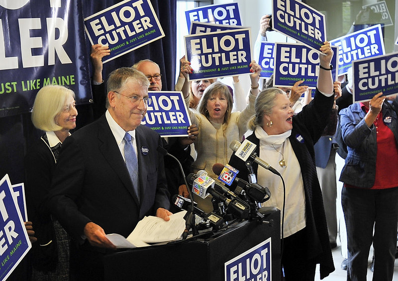 With wife Melanie Cutler behind him, Eliot Cutler announces his independent candidacy for Maine governor at a press conference Tuesday, Sept. 24., 2013 at the Gulf of Maine Research Institute in Portland.