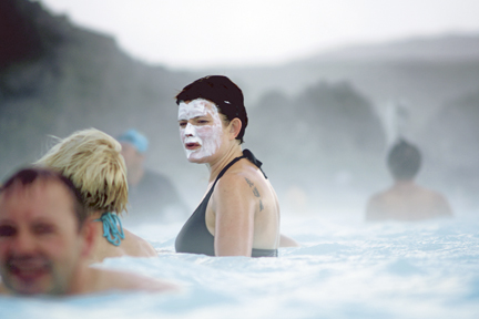 The water in the Blue Lagoon is rich in minerals like sulfa and silica. Many people like to smear silica mud on their faces while bathing.