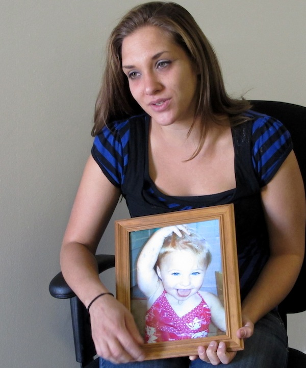 Trista Reynolds, 25, holds a photo of her 20-month-old daughter, Ayla Reynolds, during an interview with the Associated Press in Westbrook, Maine, Tuesday, Sept. 17, 2013. Reynolds, whose daughter went missing in December of 2011, says she's going to release more information she's been told by investigations in hopes of calling attention to the case and bringing it to a resolution. (AP Photo/Clarke Canfield)