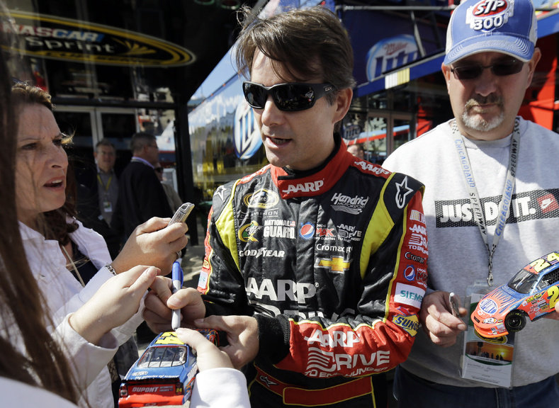 Driver Jeff Gordon signs autographs for fans as he walks to his garage during practice for Sunday's NASCAR Sprint Cup Series auto race at Chicagoland Speedway in Joliet, Ill., on Friday. NASCAR added him to the Chase field.