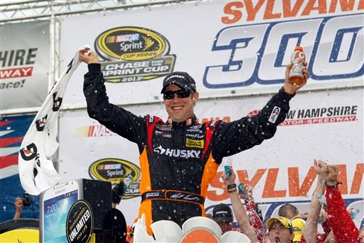 NASCAR driver Matt Kenseth celebrates in Victory Lane after winning the NASCAR Sprint Cup Series auto race at New Hampshire Motor Speedway, Sunday.