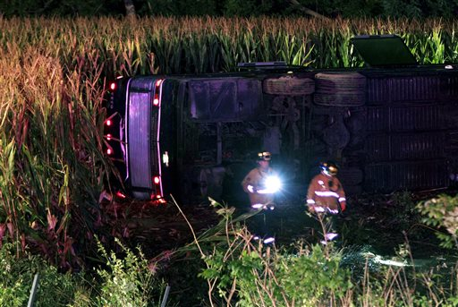 Officials work the scene of an overturned Greyhound bus on interstate I-75 in Liberty Township, Ohio, early Saturday. Authorities say that at least 34 people were hurt in the crash, with injuries ranging from minor to severe.