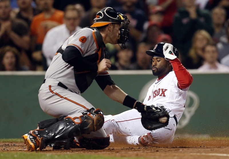 Orioles catcher Matt Wieters misses the tag as Boston's Jackie Bradley Jr. scores on a single by Dustin Pedroia in the second inning Thursday.