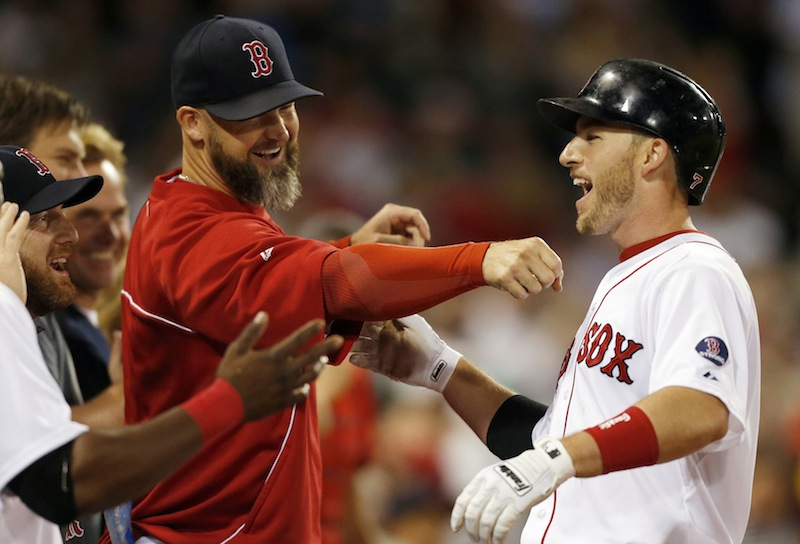 Stephen Drew, right, celebrates his two-run home run with Red Sox teammates including David Ross, center, Thursday.
