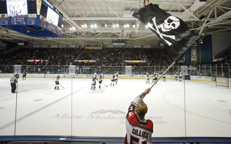 In this 2010 file photo, Dan Bailey of Yarmouth waves the Jolly Roger during a game between the Portland Pirates and Manchester Monarchs at the Cumberland County Civic Center. The Cumberland County Civic Center's trustees and the owner of the Portland Pirates may be headed to court after failing to reach an agreement on a lease that would keep the American Hockey League team playing at the arena for at least five more years.