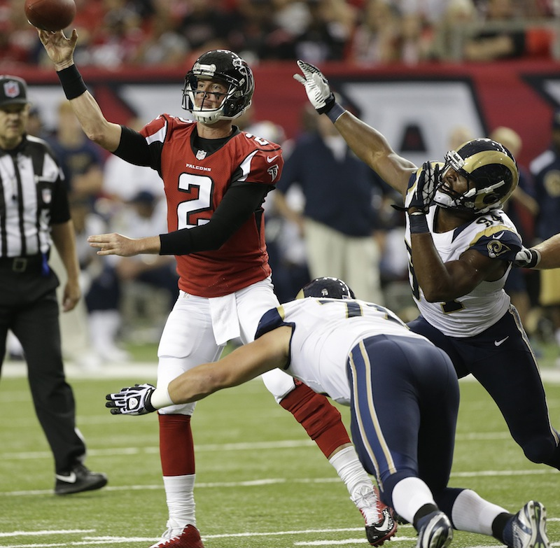 Atlanta Falcons quarterback Matt Ryan (2) works against St. Louis Rams defensive tackle Matt Conrath (71) and St. Louis Rams defensive end Robert Quinn (94) during the first half of an NFL football game, Sunday, Sept. 15, 2013, in Atlanta. (AP Photo/John Bazemore) NFLACTION13; Georgia Dome