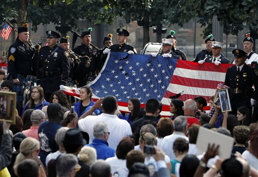 The World Trade Center Flag is presented as friends and relatives of the victims of the 9/11 terrorist attacks gather at the National September 11 Memorial at the World Trade Center site on Wednesday.