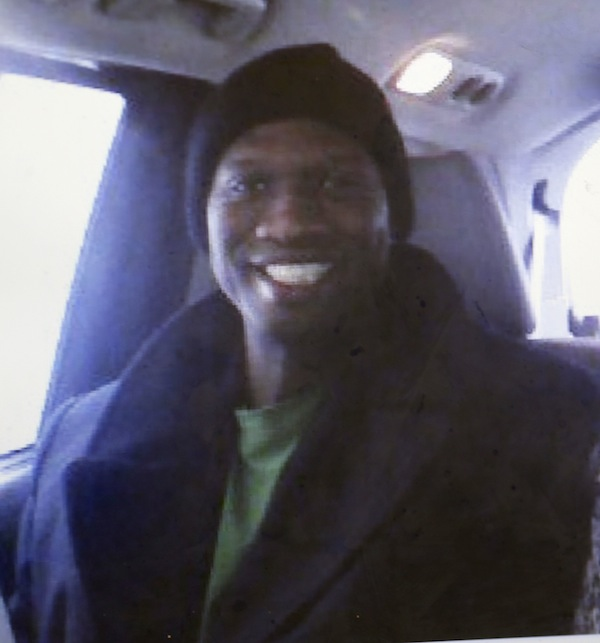 This undated cell phone photo provided by Kristi Kinard Suthamtewakul shows a smiling Aaron Alexis in Fort Worth, Texas. The FBI has identified Alexis, 34, as the gunman in the Monday, Sept. 16, 2013 shooting rampage at at the Washington Navy Yard in Washington that left thirteen dead, including himself. (AP Photo/Kristi Kinard Suthamtewakul)