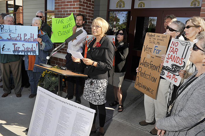 Protect South Portland, a group opposing the exporting of so-called tar sands oil out of Casco Bay, held a news conference Wednesday to list dozens of local businesses supporting their efforts. Deb Hutson, a Realtor with Keller-Williams Real Estate, speaks at the news conference.