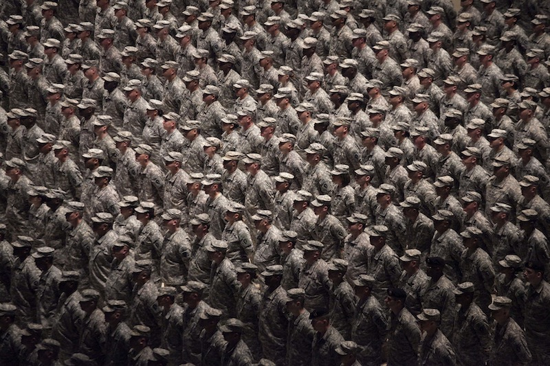 In this Sept. 26, 2010, file photo, members of the 36th Infantry Division of the Texas Army National Guard participate in a ceremony on the floor of the Frank Erwin Center in Austin, Texas. The Texas National Guard is refusing to process requests for benefits submitted by same-sex couples because of the state constitution's definition of marriage. The American Military Partner Association gave a letter to The Associated Press on Tuesday, Sept. 3, 2013, that was written by Maj. Gen. John Nichols, the commanding general of Texas Military Forces, stating that because the Texas Constitution defines marriage as between a man and a woman, his state agency couldn't process applications from gay and lesbian couples. (AP Photo/The Daily Texan, Tamir Kalifa, File) 36th Infantry Division Texas National Guard Frank Erwin Center U.S. Military Iraq