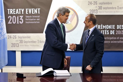 U.S. Secretary of State John Kerry, left, shakes hands with Under Secretary-General for Legal Affairs Miguel Serpa Soares after signing the Arms Trade Treaty during the 68th session of the United Nations General Assembly at U.N. headquarters, Wednesday, Sept. 25. (AP Photo/Jason DeCrow)