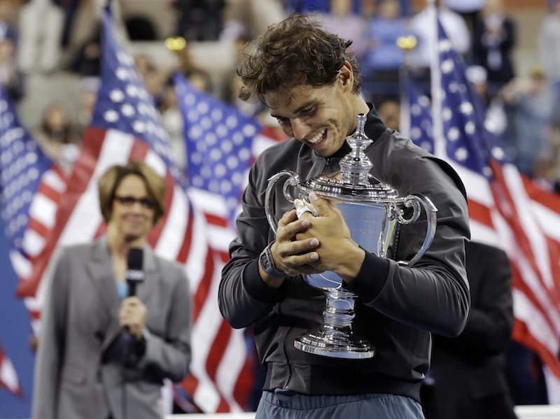 Rafael Nadal, of Spain, hugs the championship trophy after winning the men's singles final over Novak Djokovic, of Serbia, at the 2013 U.S. Open tennis tournament, Monday, Sept. 9, 2013, in New York. (AP Photo/Darron Cummings)