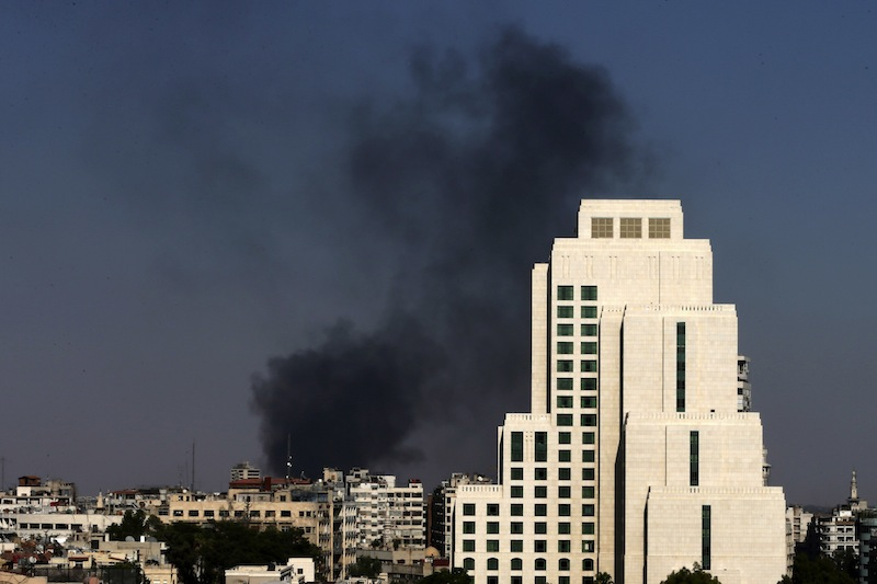 This Aug. 25, 2013 file photo shows black columns of smoke rising from heavy shelling in the Jobar neighborhood in East of Damascus, Syria. U.S. intelligence agencies did not detect the Syrian regime readying a massive chemical weapons attack in the days ahead of the strike, only piecing together what had happened after the fact, U.S. officials say. One of the key pieces of intelligence Secretary of State John Kerry later used to link the attack to the Syrian government _ intercepts of communications telling Syrian military units to prepare for the strikes _ was in the hands of U.S. intelligence agencies but had not yet been