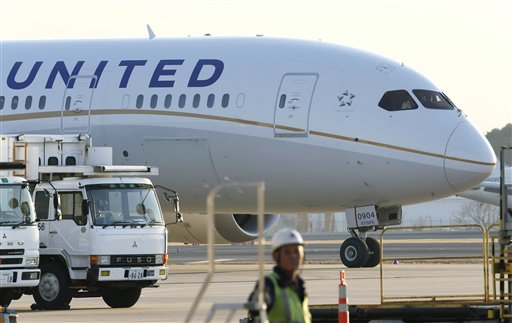 In this Thursday, Jan. 17, 2013 file photo, a United Airlines Boeing 787 is parked at Narita international airport in Narita, east of Tokyo. For a little while on Thursday, United Airlines was giving away airplane tickets for free, or close to it, accidentally posting tickets for as little as $0 and $5. (AP Photo/Kyodo News)