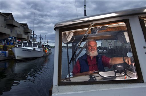 Casco Bay waterkeeper Joe Payne pilots his vessel in Portland on Wednesday. When Payne was hired 22 years ago to be the environmental steward of Casco Bay, there were only a handful of water keepers in the world. Now, there are 209 of them that oversee and protect bays, rivers, sounds, channels, inlets, lakes and creeks in 23 countries, on six continents.