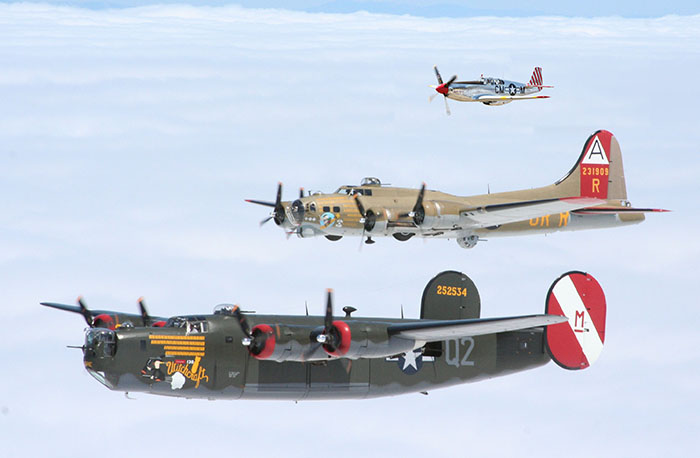 The Wings of Freedom Tour comprises a B-24 Liberator (front), a B-17 Flying Fortress and a P-51 Mustang (rear).