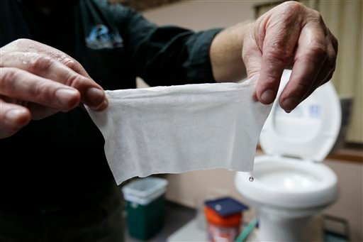 Rob Villee, executive director of the Plainfield Area Regional Sewer Authority in New Jersey, holds up a wipe he flushed through his test toilet in his office. Increasingly popular bathroom wipes – thick, premoistened towelettes that are advertised as flushable – are creating clogs and backups in sewer systems around the nation.