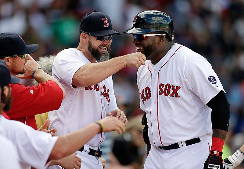 David Ortiz is welcomed to the dugout by David Ross after hitting a sixth-inning home run Sunday at Fenway Park.