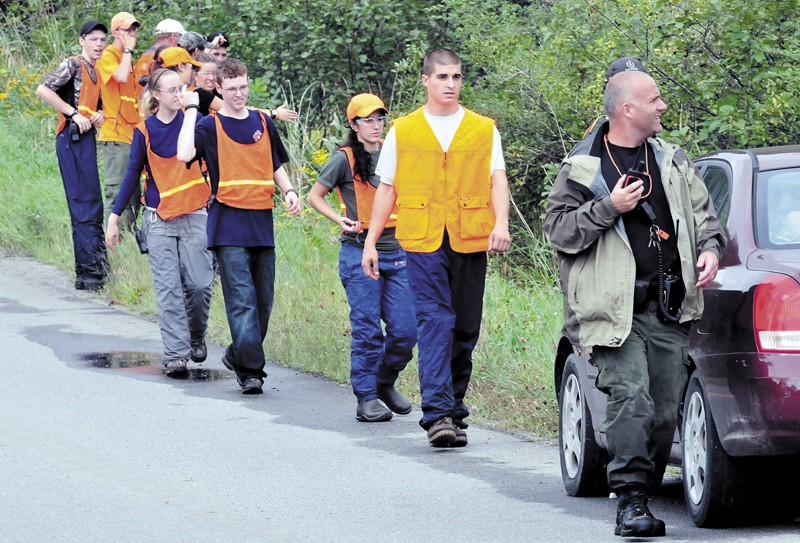 Members of Dirigo and Unity College Search and Rescue teams spread out before searching a field and woods near 344 East Benton Road in Benton for missing Arthur Wakeman, 86, on Thursday.