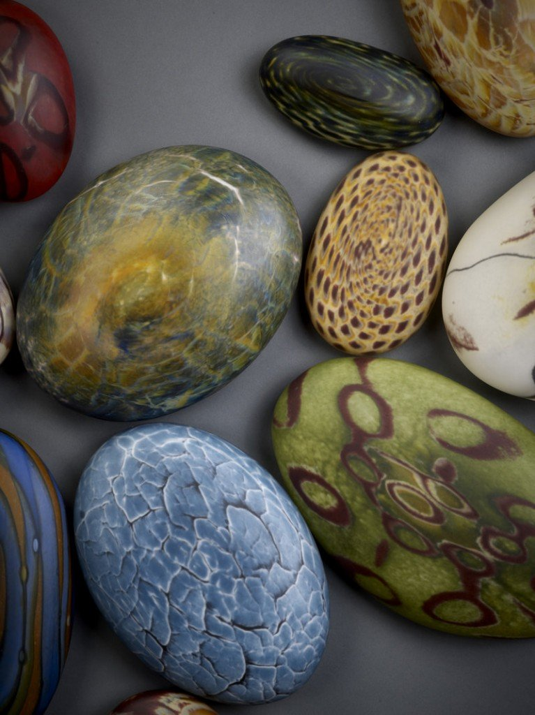 Glass is formed into shapes resembling river rocks by Thor and Jennifer Bueno of Spruce Pine, N.C.