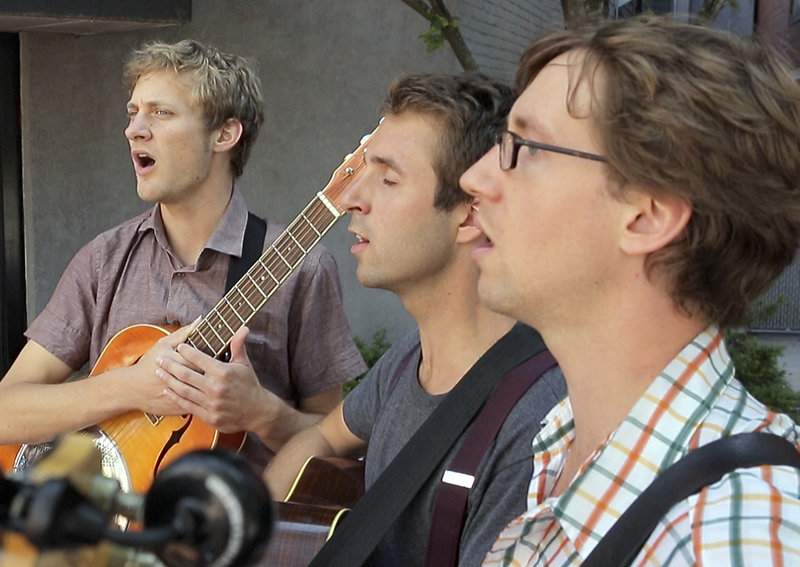 Kyle Morgan, from left, Peter Winne and Jake Hoffman sing a capella near Monument Square on Aug. 14.