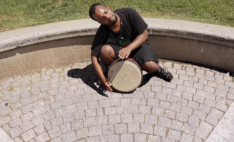 Said Anwar Cato-King plays his djembe at Bell Buoy Park on Commercial Street on July 30.