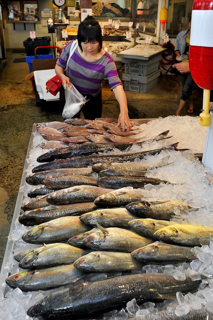 Bie Wu of Portland studies her options at the market.