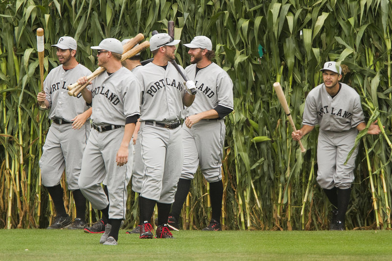 "Dressed in the uniforms of the 1926 Portland Eskimos, the Portland Sea Dogs emerge from the cornstalks in center field during the annual ""Field of Dreams"" fan appreciation day at Hadlock Field on Sunday. The Trenton Thunder, however, turned on the power in a 9-4 win."