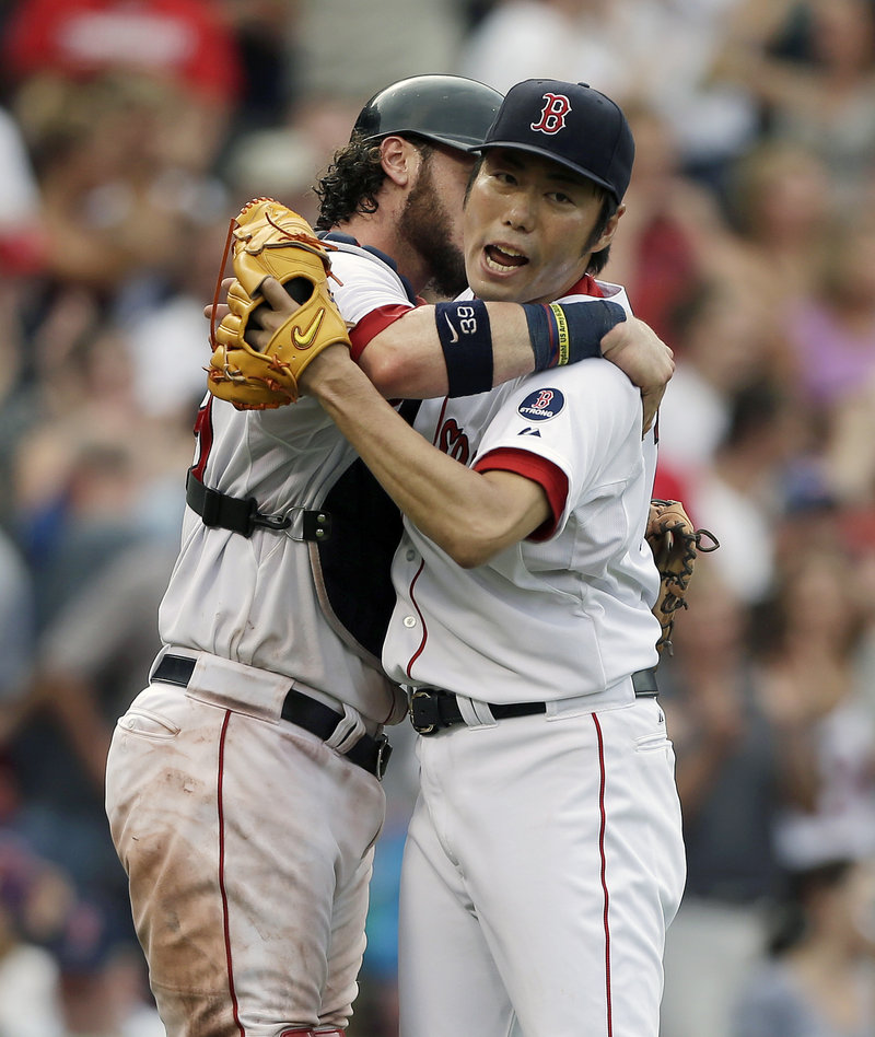Boston's Koji Uehara, right, celebrates with Jarrod Saltalamacchia after the Red Sox beat the White Sox 7-6 at Fenway Park on Sunday.