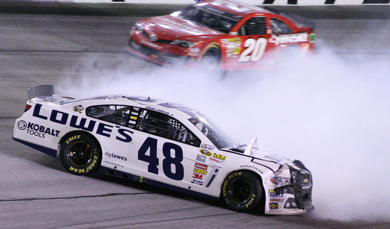 Jimmie Johnson slides through Turn 4 as Matt Kenseth safely gets by during Sunday's race at Atlanta Motor Speedway.