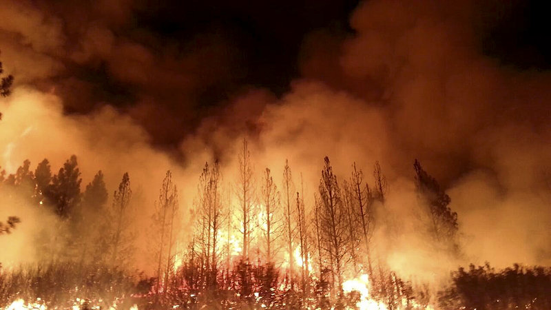 The Rim Fire, shown in a photo from the U.S. Fire Service, burns near Yosemite National Park. Scientists predict it will burn until autumn storms arrive.