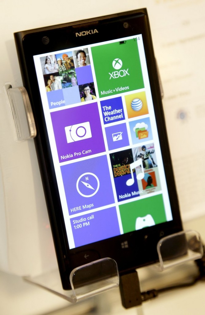 A Nokia phone runs Windows software, which could be a more common sight after Microsoft's $7.2 billion acquisition of the Finnish cellphone company.