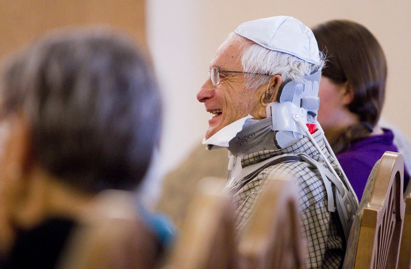 Carl Lerman, 86, resident of The Cedars retirement community in Portland, laughs during a Rosh Hashanah service, after stating his new year's wish to be