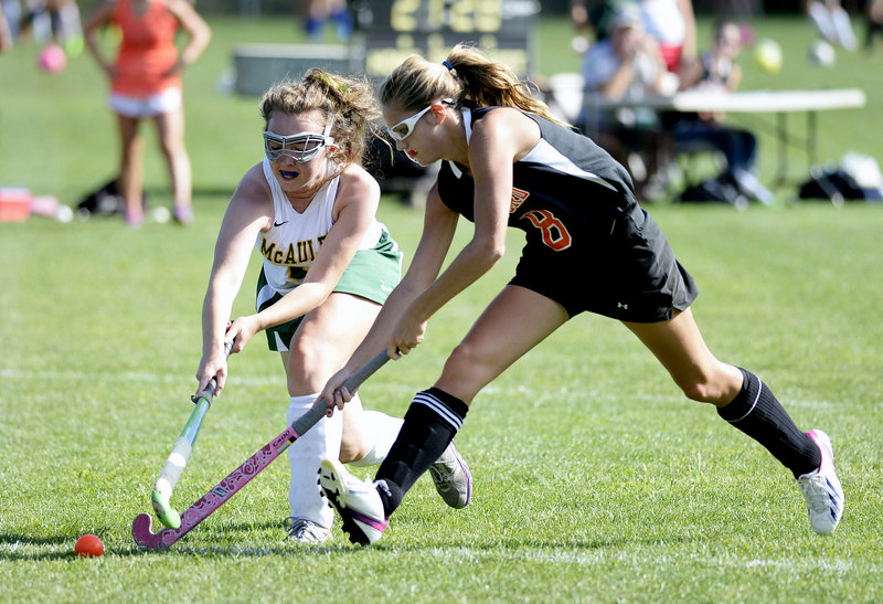 Katelyn Perkins of Biddeford, right, and Sophie Warren of McAuley compete for the field hockey ball Wednesday during Biddeford's 16-0 victory in an SMAA opener at Portland.