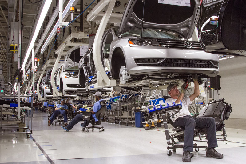 Employees work on the Passat sedan assembly line at the VW plant in Chattanooga, Tenn. Volkswagen faces pressure from labor interests to grant workers a stronger voice at the plant.
