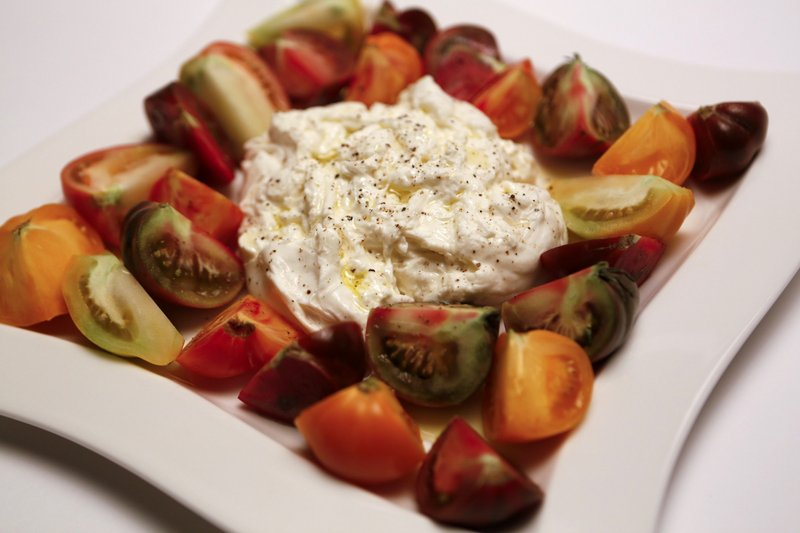 Burrata surrounded by heirloom tomatoes