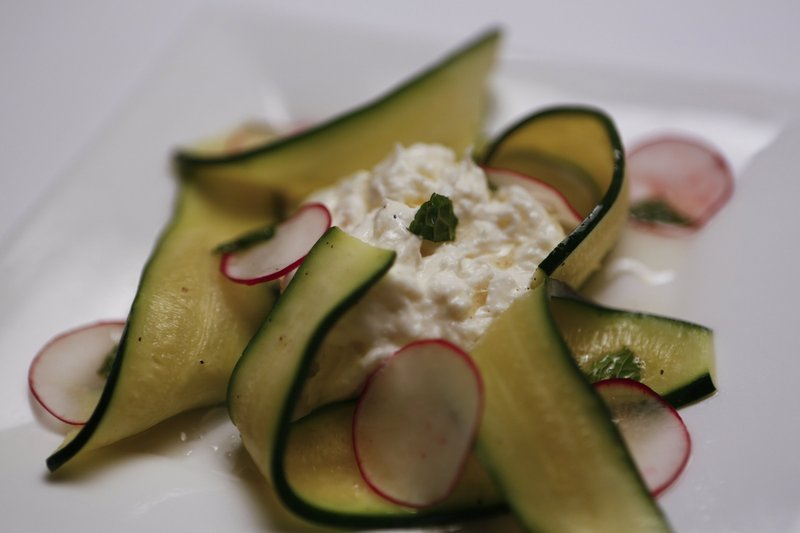Shaved zucchini, radishes and mint topped with burrata