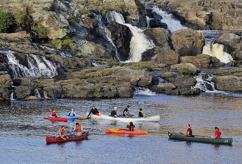 "First arrivals to the Great Falls enjoy socializing in their kayaks and canoes as they await later arrivals during the Androscoggin Land Trust's ""Paddle After Hours"" last week, an event organized by Jonathan LaBonte, Auburn's mayor and the land trust's executive director."
