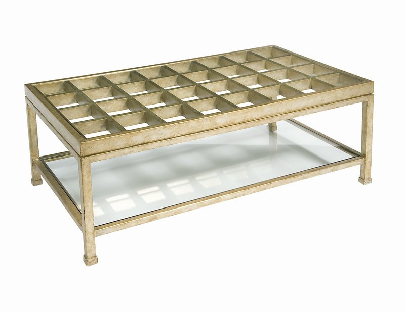 A gilded finish gives Pearson's 9744 Cocktail Table a feeling of luxury. The glass-topped table has a lower shelf for display.