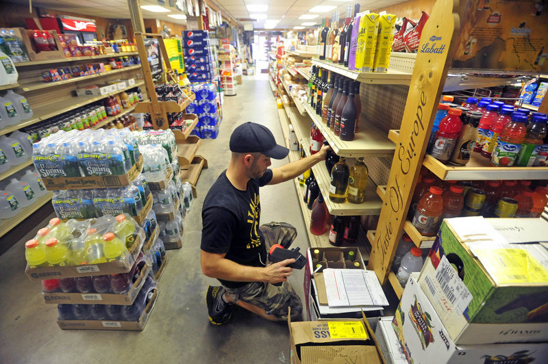 Brandon Berry stocks shelves during his afternoon shift at the family's general store.