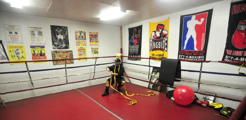 Brandon Berry's home gym is in the former service garage next to his family's general store in West Forks Plantation.