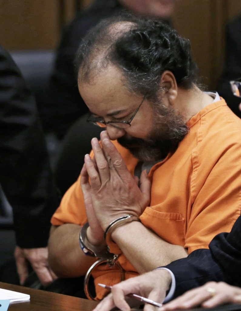 Ariel Castro listens to his sentencing Aug. 1 in Cleveland. The 53-year-old was found hanged in his cell Sept. 3 at the Correctional Reception Center in Orient, Ohio.