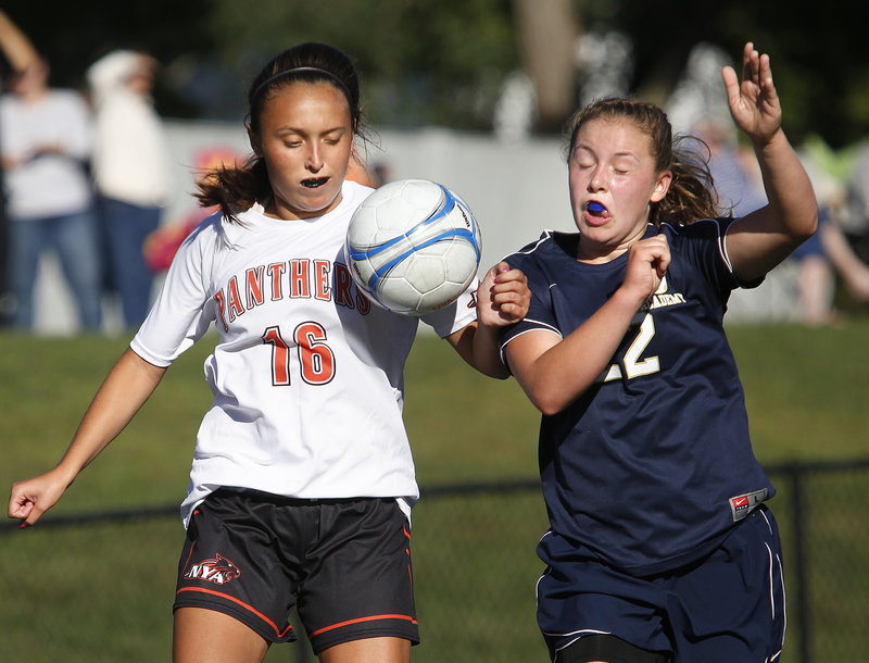 Chloe Leishman, left, of North Yarmouth Academy battles for control of the ball with Sarah Montembeau of Traip Academy during a Western Maine Conference season opener Friday. Leishman scored NYA's first goal in a 2-0 win.